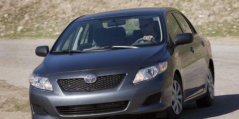 Motor vehicle, Tire, Automotive design, Daytime, Vehicle, Automotive mirror, Land vehicle, Transport, Headlamp, Infrastructure,