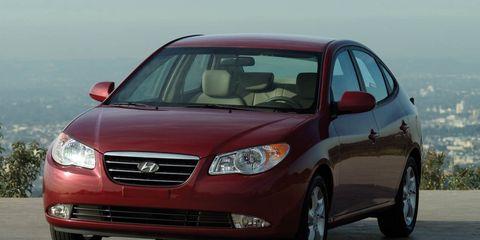 Motor vehicle, Tire, Automotive mirror, Mode of transport, Automotive design, Daytime, Vehicle, Transport, Glass, Automotive lighting,