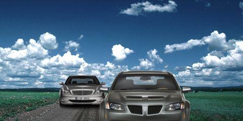 Automotive design, Daytime, Vehicle, Hood, Land vehicle, Grille, Cloud, Automotive exterior, Car, Automotive lighting,