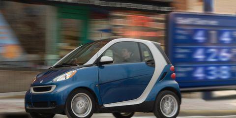 Tire, Motor vehicle, Wheel, Mode of transport, Automotive design, Blue, Transport, Automotive mirror, Automotive tire, Automotive wheel system,