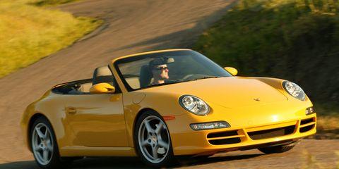 Automotive design, Vehicle, Yellow, Car, Sports car, Alloy wheel, Performance car, Luxury vehicle, Convertible, Rim,