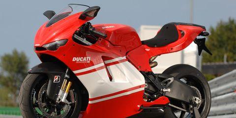Motorcycle, Motor vehicle, Tire, Wheel, Mode of transport, Automotive design, Automotive tire, Transport, Automotive lighting, Rim,