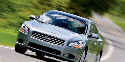 Tire, Automotive design, Daytime, Automotive mirror, Vehicle, Road, Land vehicle, Car, Infrastructure, Headlamp,