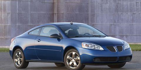 Tire, Motor vehicle, Wheel, Mode of transport, Blue, Automotive mirror, Automotive design, Daytime, Vehicle, Glass,