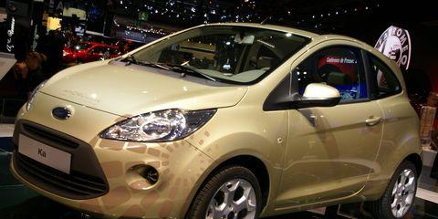 Tire, Wheel, Motor vehicle, Automotive mirror, Mode of transport, Automotive design, Vehicle, Product, Event, Land vehicle,
