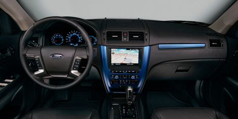 Motor vehicle, Product, Transport, Automotive design, Electronic device, Steering part, Center console, Steering wheel, Technology, Vehicle audio,