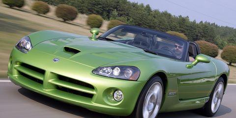 Automotive design, Vehicle, Hood, Land vehicle, Automotive mirror, Headlamp, Performance car, Car, Fender, Sports car,