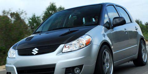 Motor vehicle, Tire, Wheel, Automotive mirror, Automotive design, Blue, Daytime, Vehicle, Transport, Land vehicle,