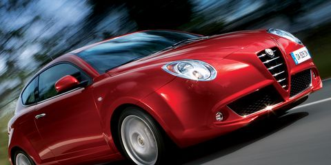 Motor vehicle, Tire, Mode of transport, Automotive design, Vehicle, Automotive mirror, Land vehicle, Grille, Car, Red,