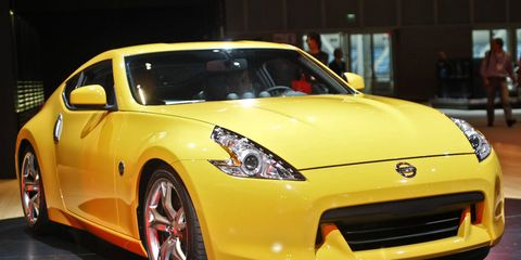 Tire, Wheel, Motor vehicle, Automotive design, Vehicle, Yellow, Land vehicle, Car, Performance car, Automotive lighting,
