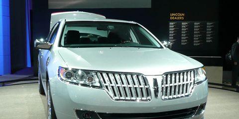 Motor vehicle, Automotive design, Product, Vehicle, Event, Land vehicle, Car, Automotive lighting, Grille, Automotive exterior,