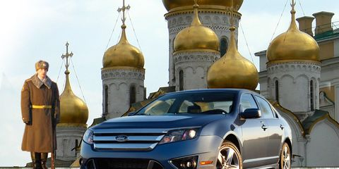 Vehicle, Dome, Architecture, Car, Technology, Fender, Automotive lighting, Dome, Rim, Place of worship,