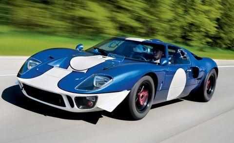 Wheel, Automotive design, Vehicle, Car, Automotive tire, Performance car, Sports car, Headlamp, Hood, Race car,