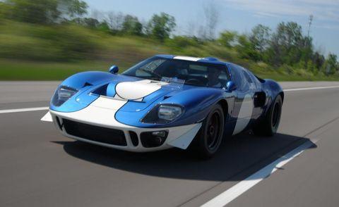 Mode of transport, Automotive design, Blue, Vehicle, Road, Hood, Performance car, Headlamp, Sports car, Car,