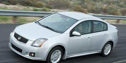 Motor vehicle, Tire, Wheel, Automotive mirror, Daytime, Vehicle, Automotive design, Land vehicle, Infrastructure, Car,