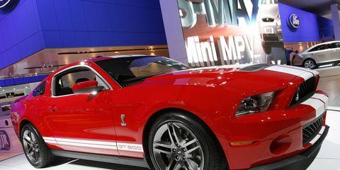 Motor vehicle, Tire, Automotive design, Automotive tire, Vehicle, Land vehicle, Hood, Car, Rim, Red,