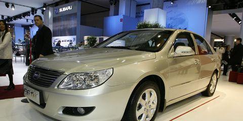 Motor vehicle, Mode of transport, Vehicle, Automotive design, Land vehicle, Event, Car, Automotive lighting, Alloy wheel, Glass,