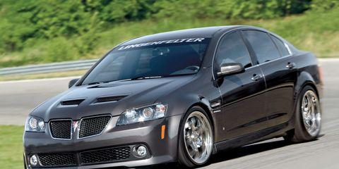 Tire, Automotive design, Daytime, Vehicle, Automotive tire, Hood, Infrastructure, Road, Rim, Automotive lighting,
