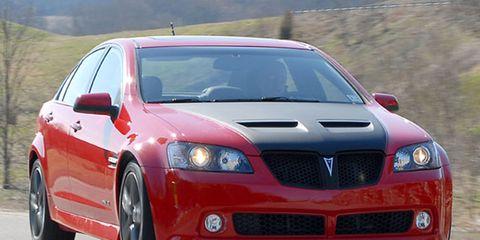Mode of transport, Automotive design, Vehicle, Infrastructure, Car, Hood, Red, Grille, Rim, Automotive mirror,