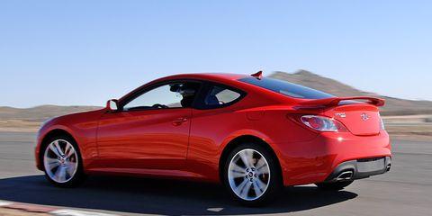 Tire, Wheel, Mode of transport, Automotive design, Vehicle, Red, Car, Landscape, Rim, Alloy wheel,