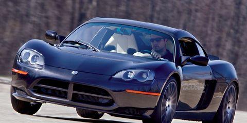 Tire, Wheel, Automotive design, Vehicle, Land vehicle, Automotive tire, Car, Headlamp, Performance car, Rim,