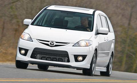 motor vehicle, tire, wheel, automotive design, daytime, vehicle, transport, land vehicle, headlamp, automotive mirror,