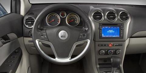 Motor vehicle, Mode of transport, Automotive design, Steering part, Steering wheel, Transport, White, Center console, Car, Speedometer,