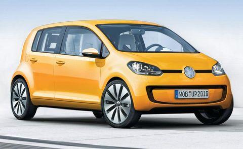 Motor vehicle, Tire, Wheel, Automotive mirror, Mode of transport, Automotive design, Daytime, Transport, Yellow, Vehicle,