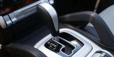 Motor vehicle, Automotive design, Steering part, Center console, Steering wheel, Luxury vehicle, Personal luxury car, Gear shift, Vehicle audio, Machine,