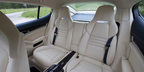 Land vehicle, Vehicle, Car, Luxury vehicle, Car seat cover, Personal luxury car, Car seat, Automotive design, Head restraint, Seat belt,
