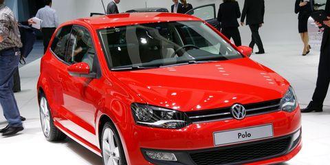 Automotive design, Vehicle, Event, Land vehicle, Car, Red, Auto show, Hatchback, Exhibition, Bumper,