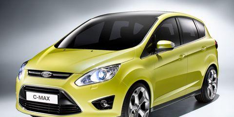 Tire, Motor vehicle, Wheel, Automotive mirror, Mode of transport, Automotive design, Daytime, Vehicle, Transport, Yellow,