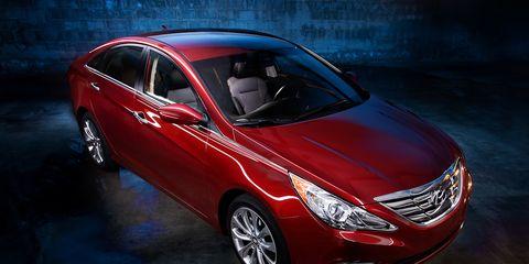 Mode of transport, Automotive design, Vehicle, Land vehicle, Automotive lighting, Car, Red, Grille, Headlamp, Mid-size car,