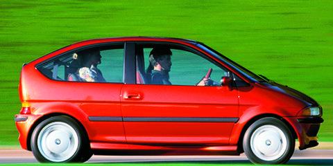 Tire, Wheel, Automotive design, Vehicle, Land vehicle, Green, Vehicle door, Automotive mirror, Red, Car,