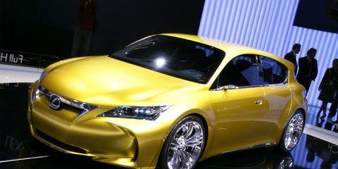 Automotive design, Vehicle, Yellow, Event, Land vehicle, Transport, Car, Automotive lighting, Fender, Auto show,
