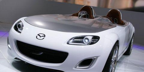 Automotive design, Vehicle, Land vehicle, Performance car, Car, Automotive mirror, Headlamp, Automotive lighting, Grille, Sports car,