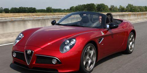 Tire, Mode of transport, Automotive design, Automotive mirror, Vehicle, Land vehicle, Performance car, Car, Headlamp, Red,