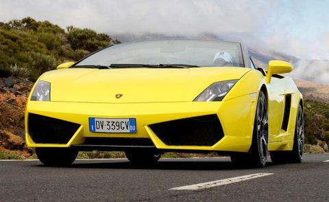Tire, Motor vehicle, Wheel, Mode of transport, Automotive design, Transport, Vehicle, Yellow, Automotive exterior, Rim,