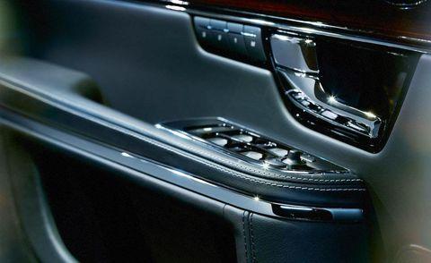 Motor vehicle, Automotive design, Personal luxury car, Luxury vehicle, Vehicle door, Carbon, Machine, Gloss, Center console, Silver,