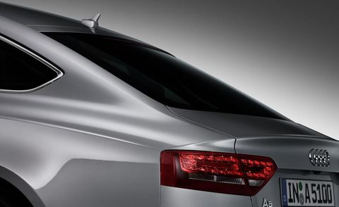 Automotive tail & brake light, Automotive design, Automotive exterior, Vehicle, Automotive lighting, Car, Personal luxury car, Luxury vehicle, Logo, Mid-size car,