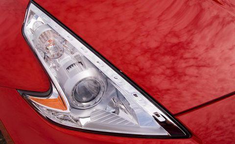 Automotive design, Automotive lighting, Headlamp, Automotive parking light, Automotive exterior, Automotive tail & brake light, Light, Hood, Logo, Automotive light bulb,