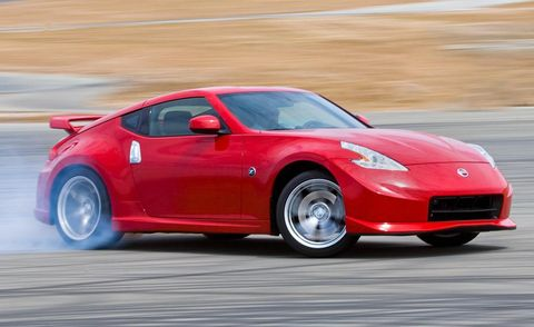 Tire, Wheel, Automotive design, Vehicle, Land vehicle, Car, Performance car, Red, Automotive lighting, Rim,
