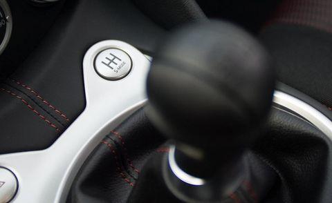 Motor vehicle, Mode of transport, Automotive design, Steering wheel, Steering part, Speedometer, Gauge, Luxury vehicle, Measuring instrument, Carbon,