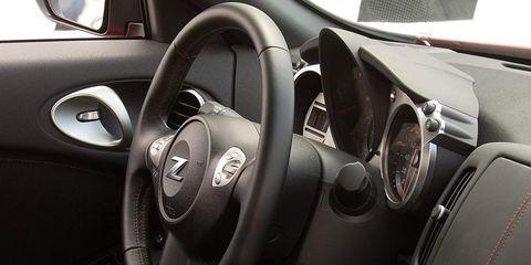 Motor vehicle, Automotive design, Steering wheel, White, Car, Steering part, Grey, Luxury vehicle, Speedometer, Personal luxury car,