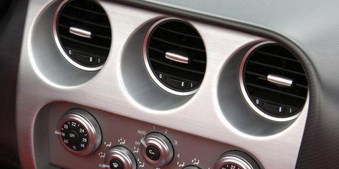 Motor vehicle, Gauge, Speedometer, Steering wheel, Luxury vehicle, Measuring instrument, Auto part, Tachometer, Gear shift, Steering part,