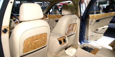 Motor vehicle, Automotive design, Car seat, Head restraint, Car seat cover, Vehicle door, Luxury vehicle, Beige, Automotive window part, Bentley,