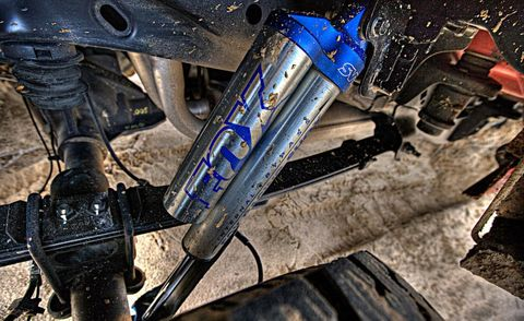 Motorcycle, Auto part, Motorcycle accessories, Machine, Electric blue, Carbon, Suspension part, Suspension, Bicycle accessory, Engine,