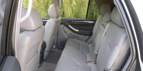 Motor vehicle, Vehicle, Car seat, Vehicle door, Car seat cover, Head restraint, Fixture, Seat belt, Luxury vehicle, Family car,