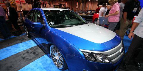 Vehicle, Automotive design, Event, Land vehicle, Car, Auto show, Exhibition, Alloy wheel, Luxury vehicle, Personal luxury car,