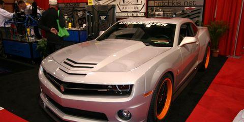 Motor vehicle, Automotive design, Vehicle, Land vehicle, Hood, Grille, Headlamp, Car, Rim, Fender,